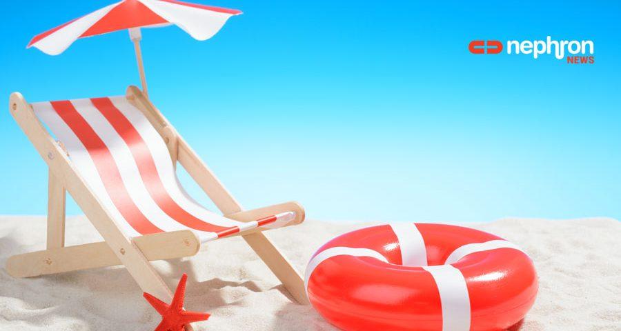 κοκκινη ομπρελα και σωσιβιο σε παραλια