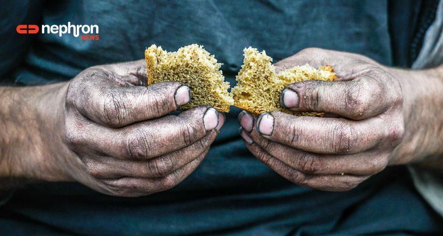 χέρια με ενα κομμάτι ψωμί
