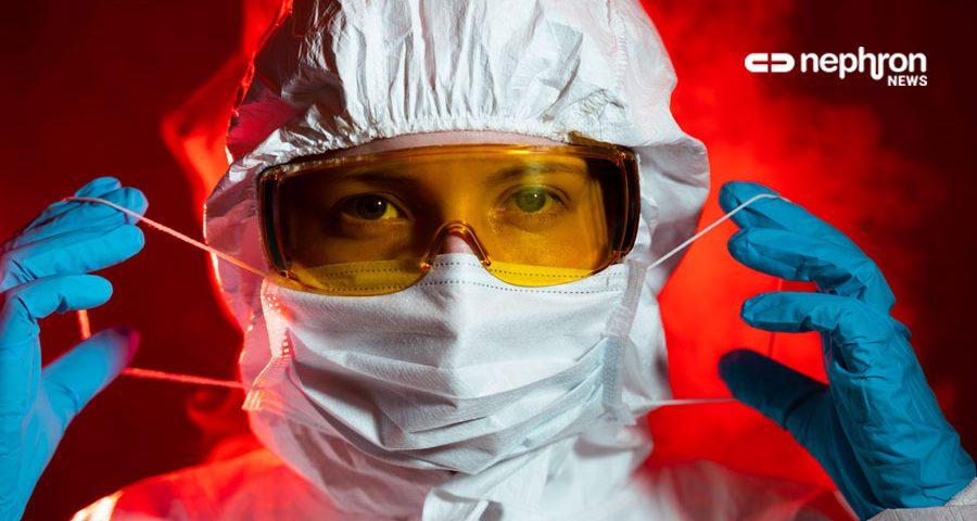 γιατρός σε κόκκινο φόντο φοράει την μάσκα του