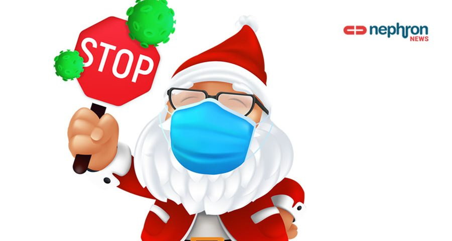 Cute santa claus wearing a surgical protective face mask and holding a stop sign with green virus cells.